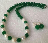 Other Necklace and earrings of green marar and off-white beads