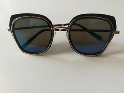Other woman sunglasses in a golden frame blue