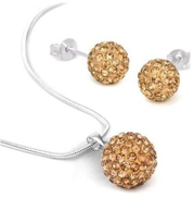 Kit and holding a golden silver plated Earrings for women