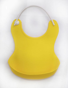 Silicone baby bib with yellow pigment